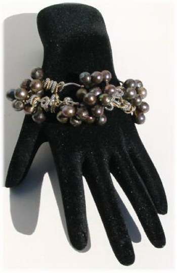 Three strands Pearls and Silver Bracelet.JPG B_FWP092706     $59.00